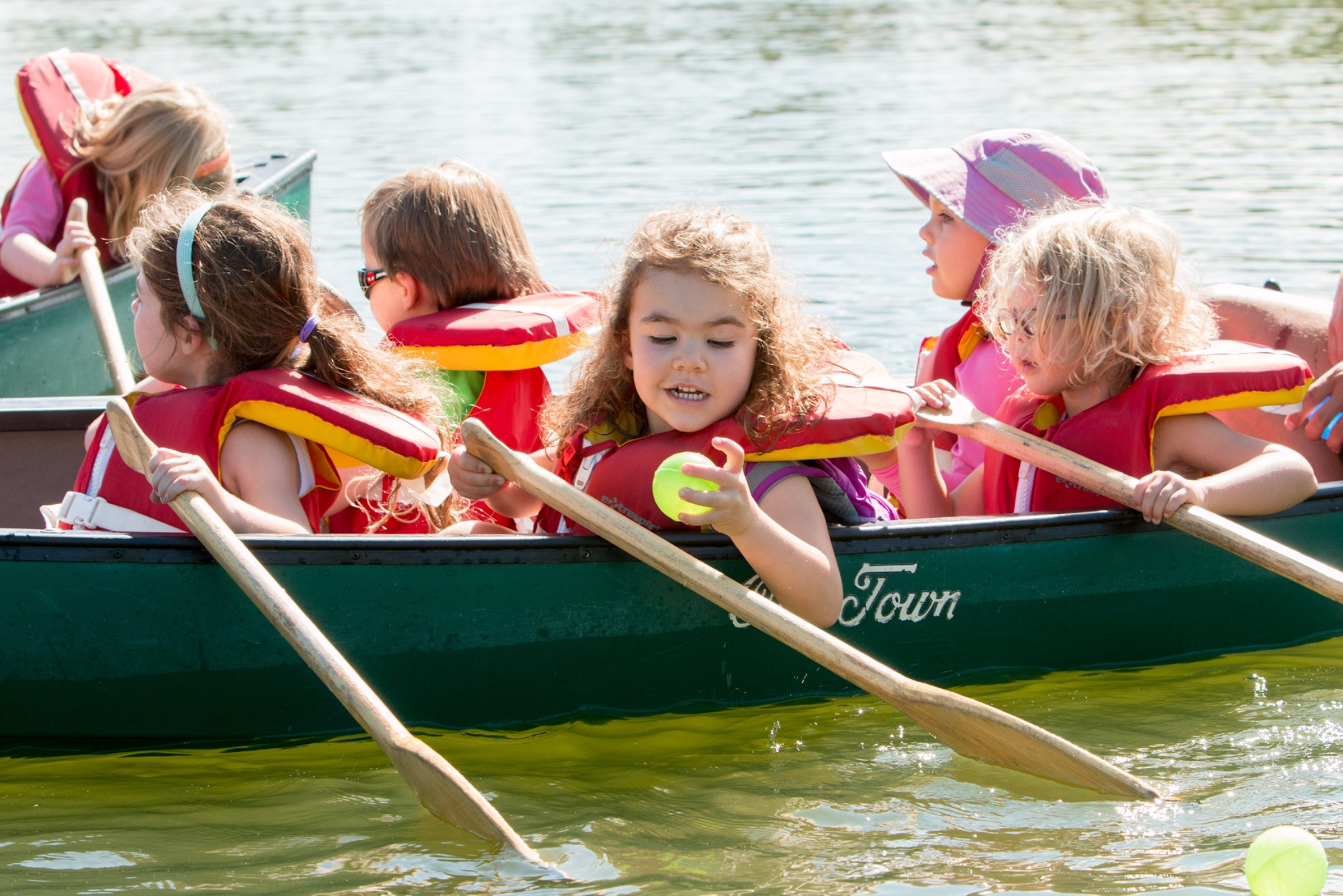 kids canoeing at outdoor adventure summer camp