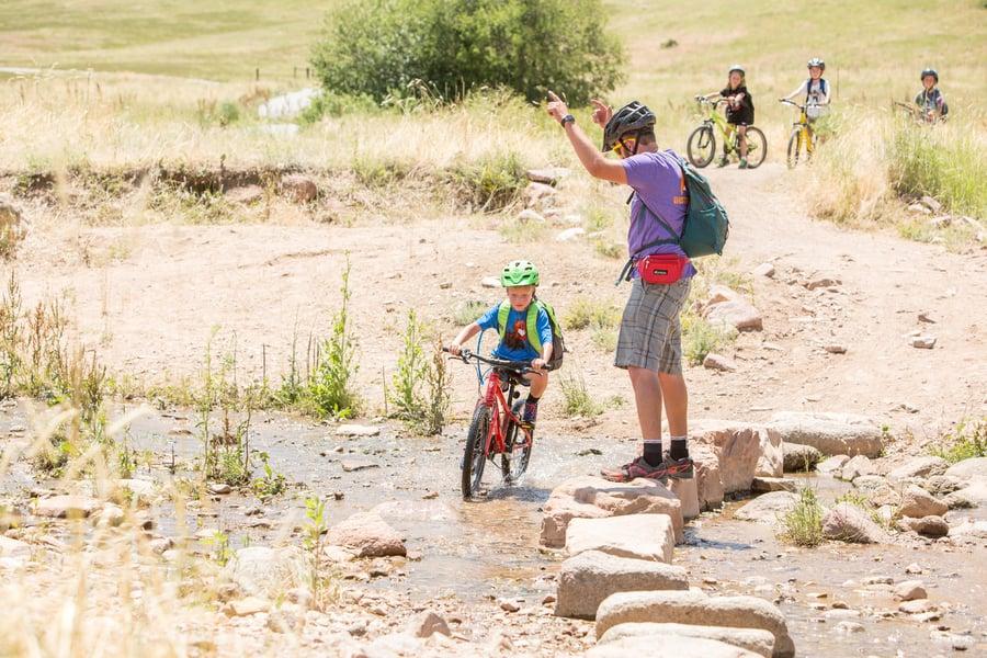 kids biking at outdoor adventure summer camp