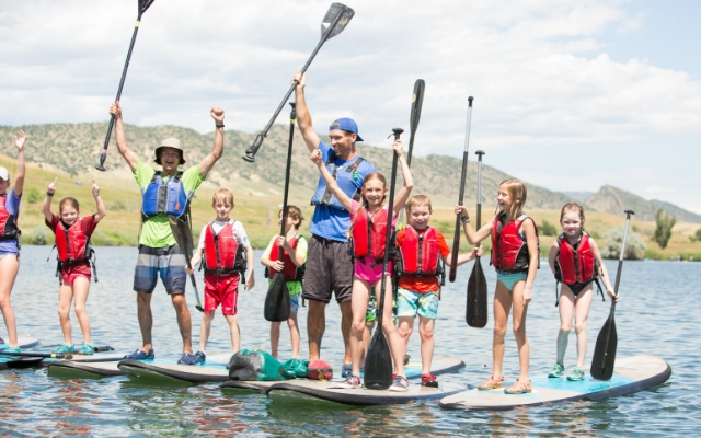 kids stand up paddleboarding summer camp