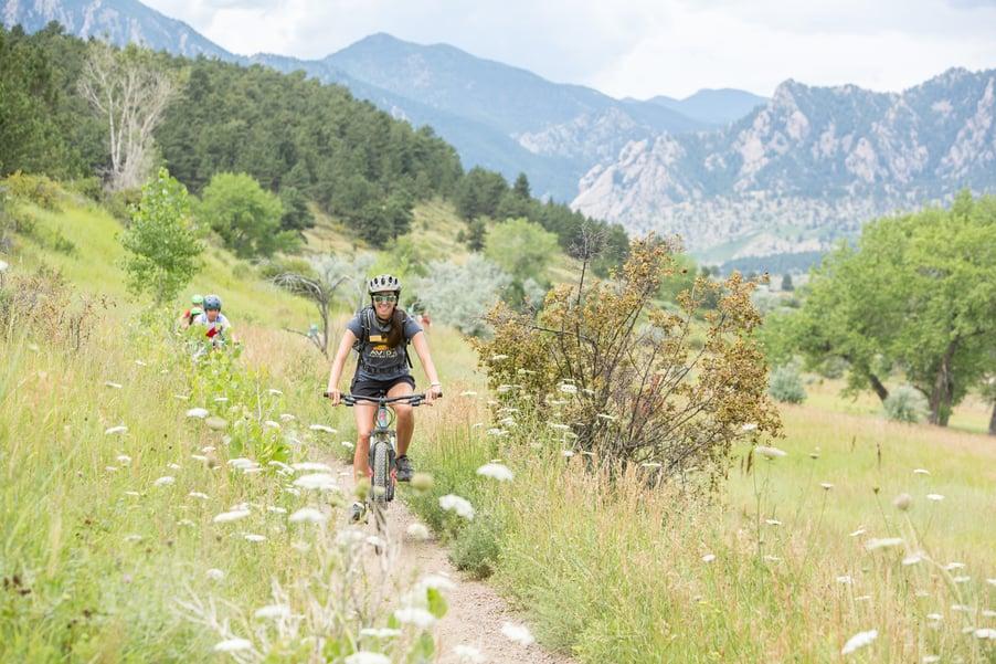 outdoor educator biking in boulder at summer camp