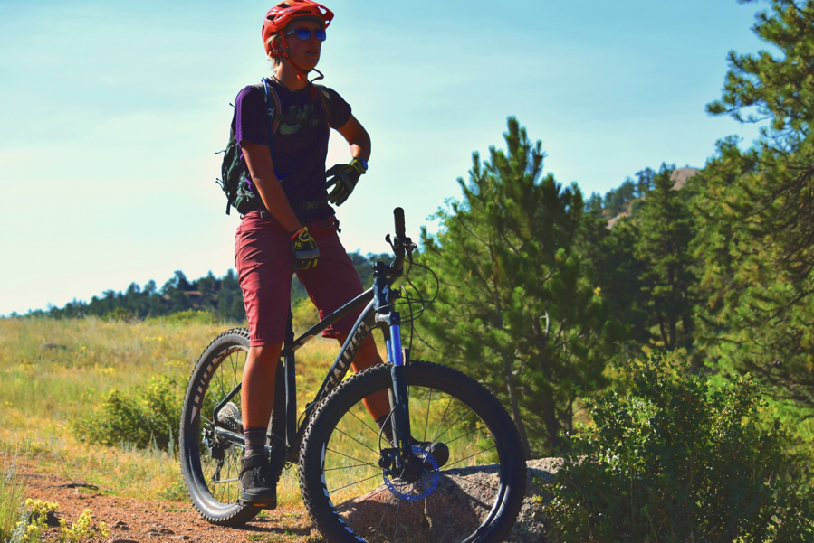 female mountain biking instructor taking a rest break