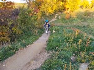 kid-biking-on-trail